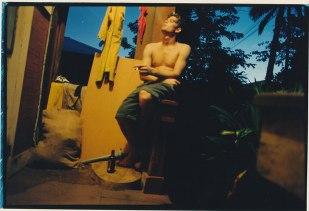 Gabe at dusk on the porch on Kou Lane.