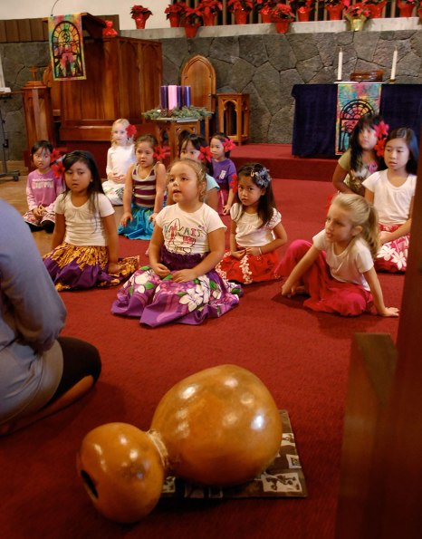 These young hula dancers, between the ages of 6 and 8 are preparing for their Chrismas hula performance at the local church.