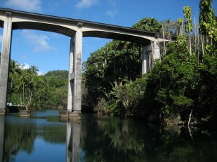 The Honolii Bridge towers over a popular surf spot.